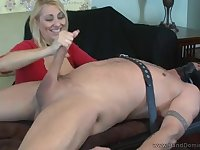 A full-bosomed older woman strokes a knob and rides it