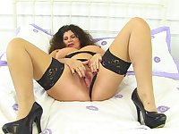Mature BBW in stockings pleasures her hot pussy