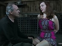 Lustful chick Maggie Mead is tied up and punished in the dark basement